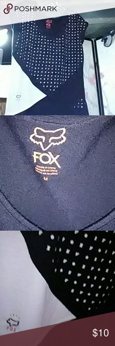 Fox racing size medium shoulder strap shirt Please read before purchase pic.. number 1 is not the T shirt I'm selling,just a very similar shirt to show u the flow of things thanks everyone.   Fox T shirt with two black shoulder straps,sewn in,very cool radical black on white see threw print,all black backside,front has alot going on and is very catchy,smoke and pet free,no stains,no burns,no markings or bleach stains,no tags like new, Fox Tops Tees - Short Sleeve