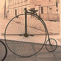 """How in the hell do you get up on this thing? Surely not in a dress or skirt. p.s. it's called a """"penny farthing"""". hm."""