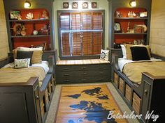 Gorgeous built-ins! Awesome for permanent living. And the world map rug is adorable for a pirate themed room!