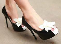 Black stiletto pump with white gardenia embellishment
