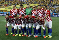 Brazil v Croatia: Group A - 2014 FIFA World Cup Brazil - The Croatian team pose for a group photo before the group A World Cup soccer match between Brazil and Croatia, the opening game of the tournament, in the Itaquerao Stadium in Sao Paulo, Brazil, Thursday, June 12, 2014. (AP Photo/Kirsty Wigglesworth)