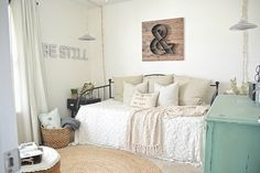 guest bedroom with a day bed & sitting area... great idea for a craft room/den/guest bedroom!