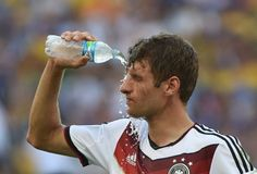 Germany's Thomas Mueller cools off during his team's 1-0 win over France in the World Cup quarterfinals.