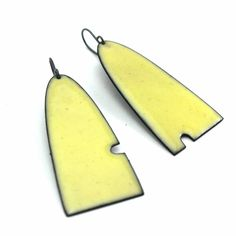 Asymmetrical Yellow Enameled Earrings by Lauren Markley. Tiny cut outs add a fun, asymmetrical touch to copper earrings, finished with a buttery yellow enamel. Ceramic Jewelry, Enamel Jewelry, Copper Jewelry, Polymer Clay Jewelry, Jewelry Art, Jewelry Design, Unique Jewelry, Fabric Jewelry, Jewellery