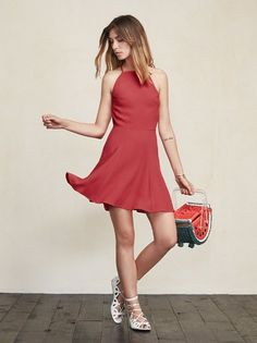 We never need a reason to go backless, and frankly neither should you.  The Dove Dress is the flirtiest little number to throw on any season, any occasion.  This is a mini fit and flare dress with a high neck line and spaghetti straps.  We know, she's really cute. Made from 43% rayon 57% lenzing viscose.
