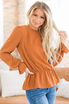 """To say we are obsessed with our Persia Woven Puff Sleeve Top would be an understatement. With its puff sleeves, ruffle bottom, and a variety of colors you're sure to make this your new fall favorite. Pair with some skinnies and booties and you're ready for a night on the town! Model Info: Models are 5'7"""", Size 2, wearing smalls Bust Measure 35"""" on size medium Body Length Measures 26"""" on size medium Sleeve Length Measures 26"""" on size medium Fabric: 100% Polyester Puff Sleeves, Size 2, How To Make, How To Wear, Bell Sleeve Top, Models, Skinny, Night, Medium"""