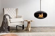 Bring a little 1960′s contemporary ski chalet to your modern home environment with the Cocoon Fireplace by Federico Otero. This ceiling-mounted, small-form fireplace cooks clean bio fuel for a bright burn without the smoke or safety hazards of a traditional fireplace. Insert the lighting mechanism, give it a spark and your room is aglow with an accent that can make your modern interior