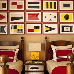 Framed nautical signal flags. More display ideas: http://www.completely-coastal.com/2010/10/flag-display.html