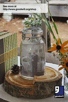 Planning a DIY/thrifty wedding? @Julia Marchand shares tips from her own, including these centerpieces that showcased old family wedding photos, made with materials from #Goodwill.