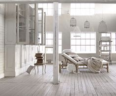 Charming white room large birdcage chandeliers
