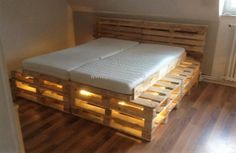 Now see the bed with the mattress and the lights illuminated under it. Isn't it looking nice? It will surely make your room look awesome with dim lighting, so save your hard earned money by managing some time and creating this simple bed idea for your home which will not cost much.