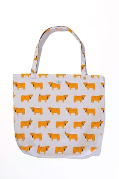 """This large shopping bag features a hand drawn print inspired by young Highland Coo's. Watch out for the little bird that appears occasionally perched on the horns and backs of some cows.    Measures: 44 x 50 cm; 73 cm strap / 17.3"""" x 19.6""""   Highland Cow Shopper by BRAW SCOTLAND. Bags - Totes Aberdeen, North East Scotland, Scotland, United Kingdom"""