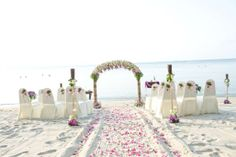A stunning mixture of pink and white using roses and thai orchids. Beach weddings, Koh Samui, Thailand