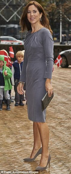 Radiating timeless beauty, the Australian-born royal beamed on the rainy Danish day in a g...