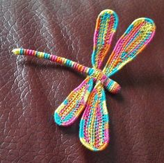 3-D Crochet Dragonfly with Wire by Josey Louis - This pattern is available as a free Ravelry download. A pattern gives you guides on how to create your own 3-D dragonfly using sewing thread crocheted around wire. If you need precise instructions this is not for you. Definately not a pattern for beginners but awesome!
