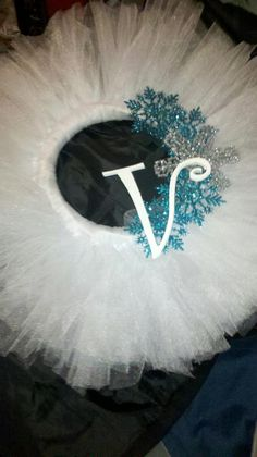 White Tulle Wreath, winter snowflakes, and a craft wooden letter. Made for a gift for a grandparent this Christmas.