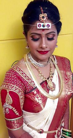 Traditional Southern Indian bride, Akshata wears bridal silk saree and jewellery for her Muhuratam. Makeup and hairstyle by Swank Studio. Red lips. Bridal jewelry. Bridal hair. Silk sari. Bridal Saree Blouse Design. Indian Bridal Makeup. Indian Bride. Gold Jewellery. Statement Blouse. Tamil bride. Telugu bride. Kannada bride. Hindu bride. Malayalee bride. Find us at https://www.facebook.com/SwankStudioBangalore