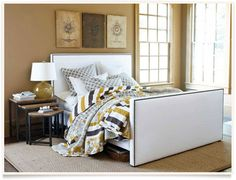 Ballard Designs  |  Francis Bedroom - similar wall color to yours - example of larger scale wall art over the bed. Also like the large natural fiber rug under the bed. I like the bedside nesting tables and lamp as well. Adds a modern touch.