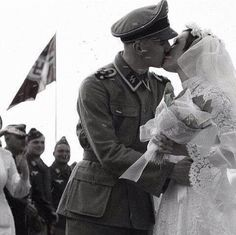 Waffen-SS soldier kissing his bride (1943)