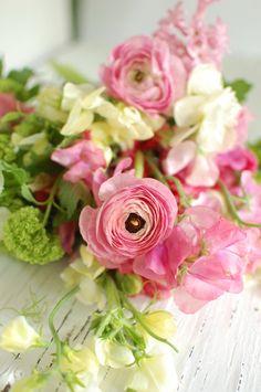 Pink ranunculus.  White sweet pea.  Pink sweet pea.  Green mini hydrangea.