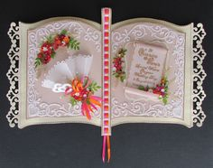 Using my Bookatrix embossing board to create two pages, I made this special gift of a wedding book card in the bright zinnia colours of shocking pink and orange, which was for our niece and her groom.