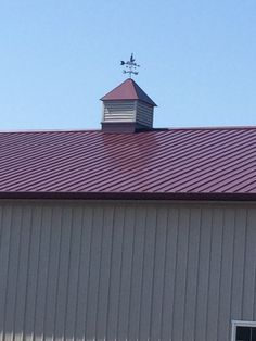 Cupola and weather vane on top of winery building