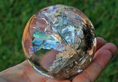 Clean quartz with feldspar as rutile needles bed and sparkling rainbow foils.