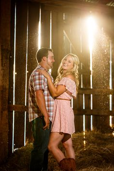 Fun engagement session in a hay loft.