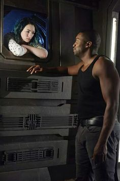"""""""Dark Matter"""", 2015, Five (in crawl space) with Six, episode 9, season 1.  Played by Jodelle Ferland and Roger Cross."""