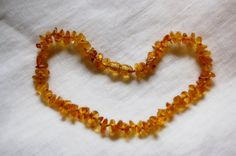 Amber necklace kid child amber necklacehoney by LovelyCraftsHome Amber Necklace, Beaded Necklace, Necklaces, Amber Teething, Dummy Clips, Teething Necklace, Child, Trending Outfits, Unique Jewelry
