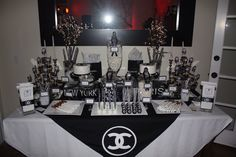 Fabulous Chanel Birthday Party. Table display, tags, cupcake toppers, Chanel logo, labels by jenaecreates.