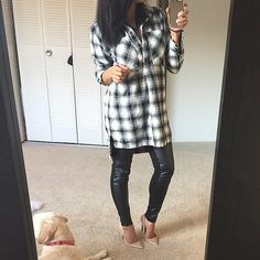 Oversized plaid tunic Worn/washed once. In perfect condition. Soft black and white plaid tunic top. Can be worn as a dress in the spring/summer for the shorter ladies. I love it with leather pants and moto boots size small but fits oversized so a medium could fit as well. Functional buttons on upper portion of tunic.  ❣Price Firm ❌NO Trades❗️  Non smoking home  Same/next day  Tops Tunics