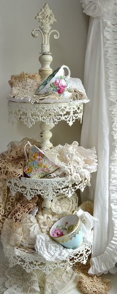 Lovely display idea for vintage laces/fabrics and dainty old tea cups~