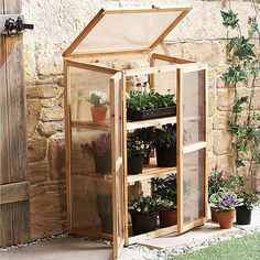 Mini Garden Greenhouse, Brookstone - I bet we could make one of these for less....
