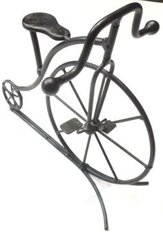 $29.89 /  Big Wheel Bicycle Black Bike cycling Sculpture with stand ~Home Decor Accent measures 8 x 9 ~sports metal art ~~see over 20 categories of merchandise in my store. I ship globally. www.shellyssweetfinds.com