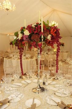 Amaranthus, Glorisa, Roses, Lilies- Lush centerpeice with both the impact of color and the romance of candles!