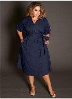 The classic wrap dress in navy blue with floral shoes