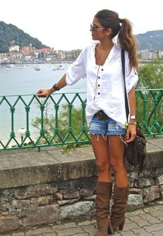 Jean shorts with boots, loose top and large bag