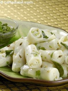Khandvi, one of the gems of gujarathi cuisine, has been transferred into faraali style, so that it can be enjoyed as a light snack on fasting days.