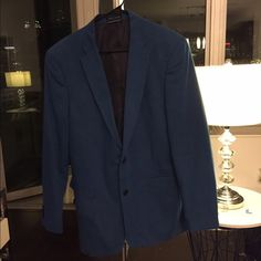Men's Tommy Hilfiger Bright Blue Two Button Blazer Men's Tommy Hilfiger Bright Blue Two Button Blazer, 100% cotton, dry cleaned, classic fit, side vented back, long sleeve with four decorative button cuffs Tommy Hilfiger Jackets & Coats Blazers