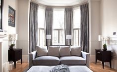 Bay Windows And Grey Curtains - Grey curtains in multiple panels make the bay window pop