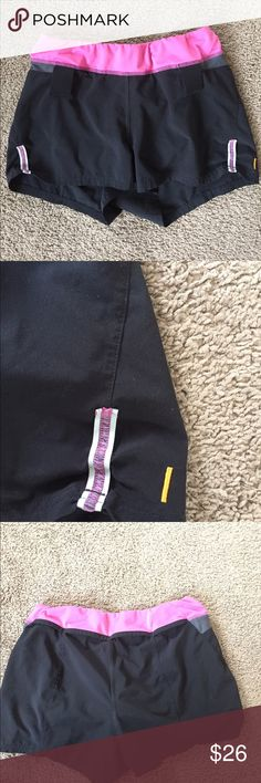 """Lucy flex shorts In excellent condition! body:has built in underwear, 86%polyester,14%spandex. Waist band: 92%polyester,8%lycro spandex, missing waist band string. Lining: 89%polyester,11%spandex. From the top of the waistband down they are 12"""" long. Lucy Pants Track Pants & Joggers"""