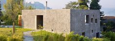 wespi de meuron romeo's concrete house in switzerland is punctured with square windows
