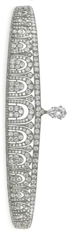 ART DÉCO DIAMOND TIARA, BY CARTIER Designed as a graduated line of old-cut diamond-set arches, between old and rose-cut diamond line borders, surmounted to the center with a pear-shaped diamond, weighing approximately 4.31 carats, 1920, with French assay marks for platinum and gold Signed Cartier Londres Paris New York, with maker's mark for Atelier Renault Image Christies