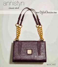Annistyn Classic Shell / Pricing to Follow  * Available in Oct / Nov to our Hostesses. Available to everyone else Dec 2013 *   Feeling glamorous? It's hard to imagine a color combination more exquisite than purple and bold metallic gold. Go ahead— feel like a movie star today!   The Annistyn for Classic Miche bags features emobossed croc faux leather and rivet details.   Perfectly matches our Interchangeable Handle Straps (purple). Base Bag and Handle not included.