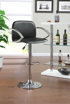 Modern Bar Stool :: The ease of black and chrome is the perfect update for a home entertainment area.
