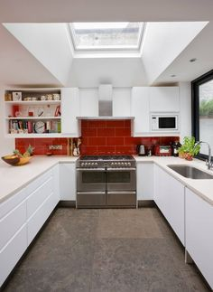 Contemporary kitchen red backsplash white cabinets - Home Decorating Trends - Homedit Contemporary Kitchen, Kitchen Remodel, Kitchen Design, Kitchen Cabinet Design, Kitchen Flooring, Modern Kitchen, Red Backsplash, Kitchen Layout, Kitchen Cabinets