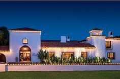Spanish Colonial Revival. Right tower with smaller top!