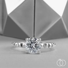 3c8cb4e4a1 This classic solitaire diamond engagement ring is anything but traditional.  Inspired by the pyramid shape
