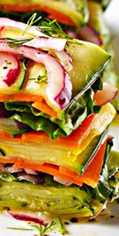Stacked Vegetable Salad - Try a sophisticated twist to your usual side salad by elegantly stacking your veggies instead. A simple vegetable peeler or mandoline works wonderfully when slicing the ingredients into thin ribbons for stacking.